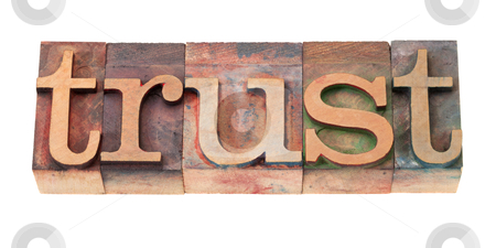 Trust word in wood fonts stock photo, trust word in vintage wooden letterpress printing blocks, stained by color inks, isolated on white by Marek Uliasz