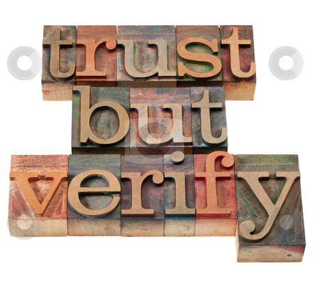 Trust but verify phrase stock photo, trust but verify  quote from  Ronald Reagan concerning relations with Soviet Union - vintage wooden letterpress printing blocks, stained by color inks, isolated on white by Marek Uliasz