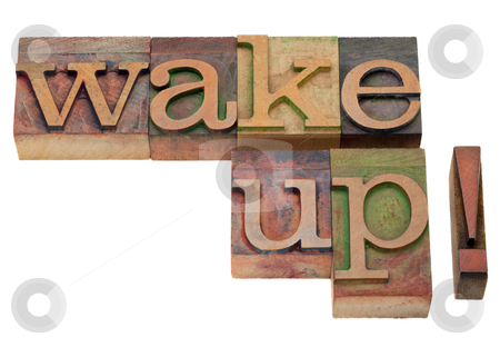 Wake up - phrase in vintage letterpress type stock photo, wake up - exclamation phrase in vintage wooden letterpress printing blocks, stained by color inks, isolated on white by Marek Uliasz
