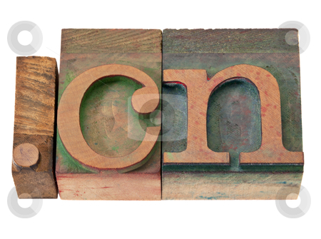 Internet in China stock photo, dot  cn - internet domain for China  in vintage wooden letterpress printing blocks, stained by color inks, isolated on white by Marek Uliasz