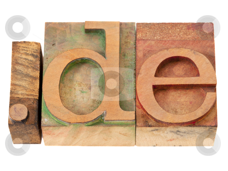 Internet domain for Germany stock photo, dot de - internet domain for Germany in vintage wooden letterpress printing blocks, stained by color inks, isolated on white by Marek Uliasz