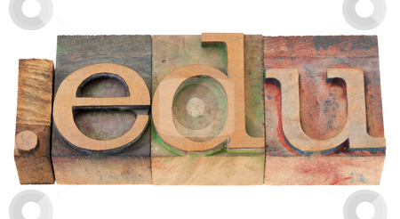 Education internet domain stock photo, dot edu - internet domain extension for educational institutions in vintage wooden letterpress printing blocks, stained by color inks, isolated on white by Marek Uliasz