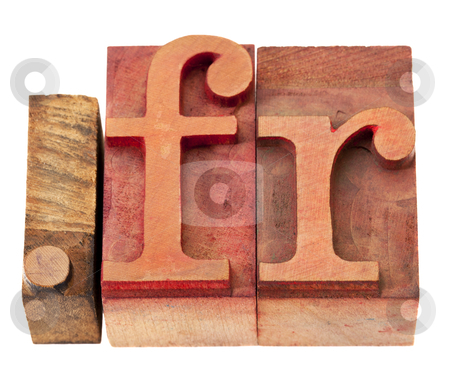 Internet domain for France stock photo, dot fr - internet domain for France in vintage wooden letterpress printing blocks, stained by color inks, isolated on white by Marek Uliasz