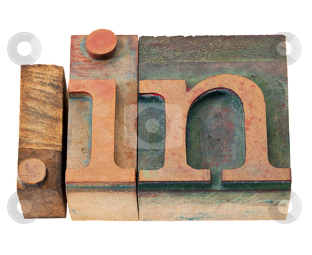 Internet in India stock photo, dot in - internet domain for India in vintage wooden letterpress printing blocks, stained by color inks, isolated on white by Marek Uliasz