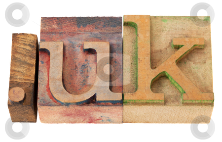 Internet domain for United Kingdom stock photo, dot uk - internet domain for United Kingdom in vintage wooden letterpress printing blocks, stained by color inks, isolated on white by Marek Uliasz