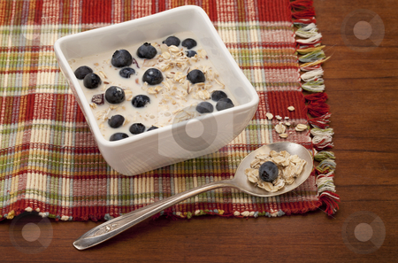 Muesli cereal breakfast stock photo, muesli cereal breakfast with blueberries and soy milk by Marek Uliasz