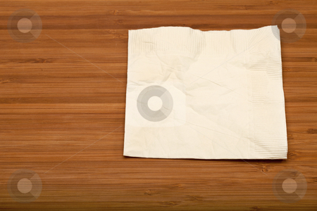 Cocktail napkin stock photo, beige cocktail napkin on wooden (Bamboo) table by Marek Uliasz