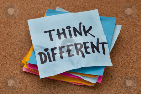 Think different concept stock photo, think different concept - motivational phrase on a stack of sticky notes against cork bulletin board by Marek Uliasz