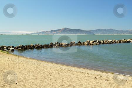 Beach on sunny day stock photo, Beach with mountains on background on sunny day by Olena Pupirina