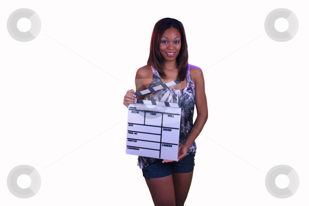 Beautiful Teen Girl with a Movie Slate stock photo, Close-up of a lovely teen with a captivating smile, holding a movie slate. by Carl Stewart