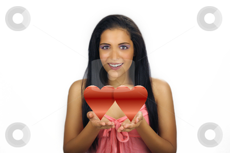 Beautiful Teen Latina Valentine stock photo, A lovely teenage Latina with long, luscious black hair and a bright, warm smile holds two graphic hearts in her cupped hands. by Carl Stewart