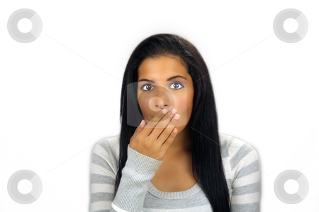 Beautiful Teen Latina Shocked or Embarrassed stock photo, A lovely teenage Latina with long, luscious black hair holds her hand in front of her mouth, apparently shocked or embarrassed. by Carl Stewart
