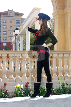 Beautiful Brunette Guard (5) stock photo, Full-length shot of a beautiful young brunette wearing a stylized costume that's remeniscent of the old British Guard, outdoors on a bright, sunny day. by Carl Stewart