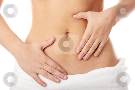 Hand on belly stock photo, Hand on belly isolated on white background by Piotr_Marcinski