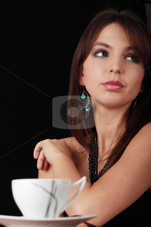 Elegant young woman drinking coffee stock photo, Elegant young woman drinking coffee, isolated on black by Piotr_Marcinski