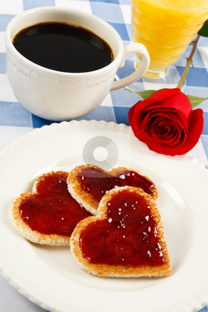 Love is in the Air! stock photo, A single red rose graces a romantic breakfast treat with heart-shaped toast by Karen Sarraga