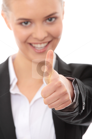 OK stock photo, Young business woman showing OK sign, looking at camera and smiling. Isolated on white background. Focus on hand by Piotr_Marcinski