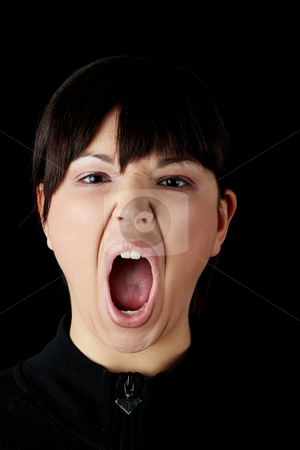 Angry young woman stock photo, Angry young woman isolated on black background