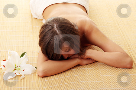 Teen girl relaxing in massage stock photo, Young woman (teen girl) relaxing in massage by Piotr_Marcinski