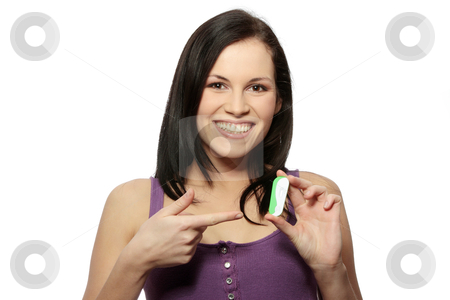 Pregnancy test stock photo, Smiling woman holding a pregnancy test, isolated on white by Piotr_Marcinski