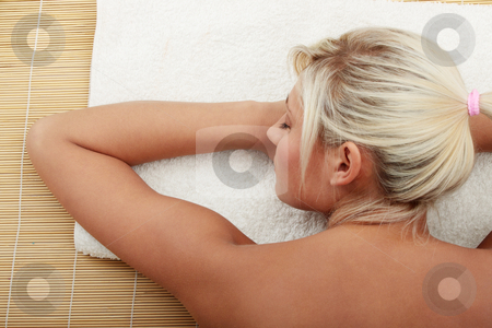 Beautiful caucasian woman getting spa treatment stock photo, Beautiful caucasian woman getting spa treatment, isolated  by Piotr_Marcinski