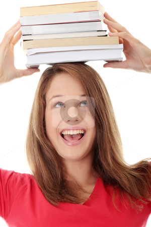 Young caucasian woman (student)  stock photo, Young caucasian woman (student) with books on her head  by Piotr_Marcinski