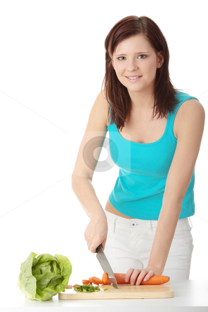 Woman preparing healthy food stock photo, Woman preparing healthy food salad with green vegetable and knife by Piotr_Marcinski