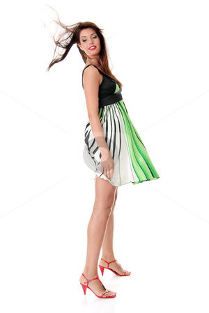 Sexy woman in skirt blown by wind stock photo, Sexy woman in skirt blown by wind, isolated on white background  by Piotr_Marcinski