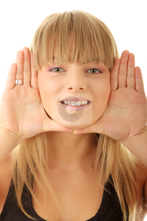 Young woman frame her face stock photo, Young woman frame her face with hands by Piotr_Marcinski