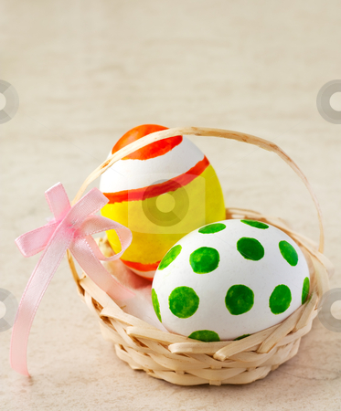 Easter eggs in basket stock photo, Painted easter eggs in a basket with ribbon by borojoint