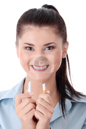 Young woman breaking cigarette stock photo, Young woman breaking cigarette over white background  by Piotr_Marcinski