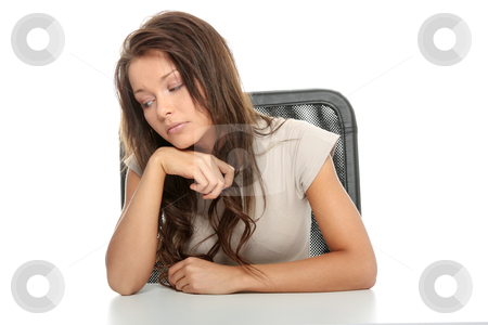 Sad woman sitting behind the desk stock photo, Sad woman sitting behind the desk, isolated on white by Piotr_Marcinski