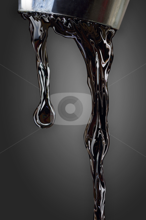 Oil dropping stock photo, Black oil dripping from faucet on dark background, isolated with clipping path included by Sauromatum Design