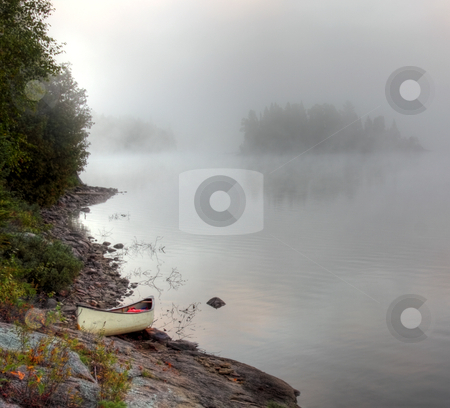 Parkside Bay Canoe stock photo, A canoe sitting on the granite shoreline of Parksid bay in Algonquin Provincial Park, in Ontario, Canada. by Chris Hill