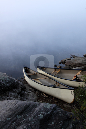 Parkside Canoes stock photo, A canoe sitting on the granite shoreline of Parksid bay in Algonquin Provincial Park, in Ontario, Canada.  by Chris Hill