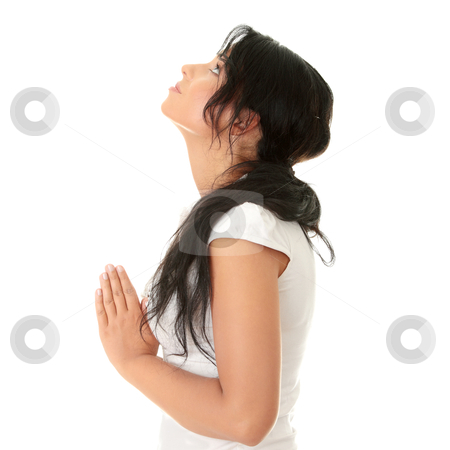 Young caucasian woman praying stock photo, Closeup portrait of a young caucasian woman praying isolated on white background by Piotr_Marcinski