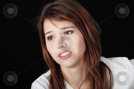 Teenage girl depression stock photo, Teenage girl depression - lost love - isolated on black background  by Piotr_Marcinski