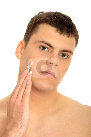 Cream stock photo, Happy man after shaving applying moisturizing cream upon his face  by Piotr_Marcinski