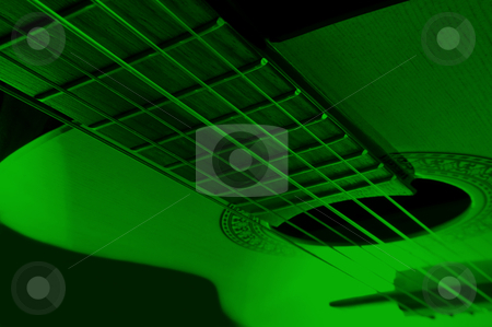 Acoustic guitar stock photo, Acoustic guitar with extreme green light effect. by Samantha Craddock