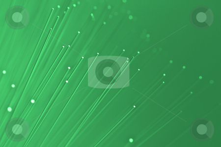Green global communications stock photo, Many ends of green illuminated fiber optic light strands close up by Samantha Craddock