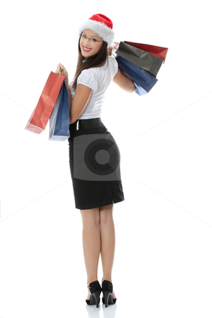 Shopping Christmas woman stock photo, Shopping Christmas woman smiling. Isolated over white background  by Piotr_Marcinski