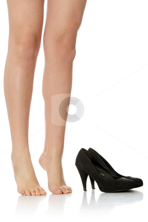 Naked female legs next to high heels stock photo, Naked female legs next to high heels, isolated on white by Piotr_Marcinski
