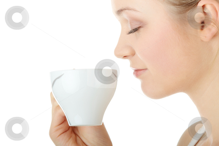 Blond woman drinking coffee stock photo, Young attractive blond woman drinking coffee, isolated on white background  by Piotr_Marcinski