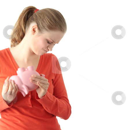 Savings stock photo, Young blond woman trying to get money from her piggy bank, isolated on white background  by Piotr_Marcinski
