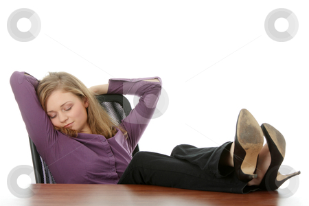 Resting stock photo, Young beautiful business lady having a rest at the working place. Isolated.  by Piotr_Marcinski