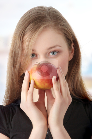 Young woman with apple stock photo, Portrait of young woman with apple, isolated on white  by Piotr_Marcinski