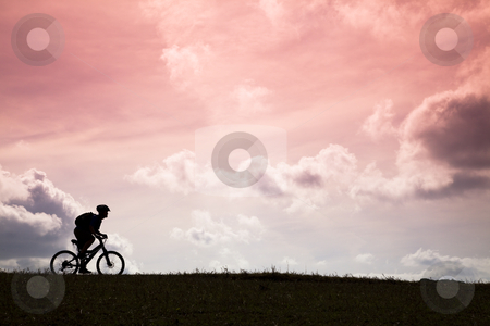 The Silhouette of mountain bike rider and sunset  stock photo, The Silhouette of mountain bike rider and sunset  by tomwang