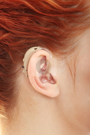 Hearing aid  stock photo, Redhead woman wearing hearing aid  by Piotr_Marcinski
