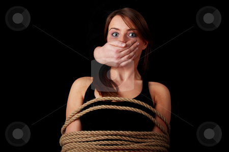 Emotional portrait of abused woman stock photo, Emotional portrait of kidnapped woman isolated on black  by Piotr_Marcinski