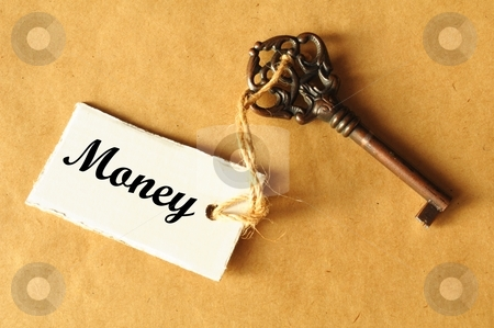 Money stock photo, money concept with key and label with word showing success by Gunnar Pippel